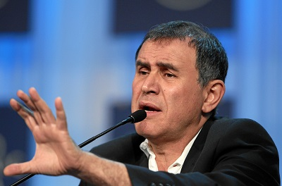 Famed economist Nouriel Roubini says President-elect Donald Trump's loose fiscal policies could weaken the U.S. dollar, which in turn would be positive for gold